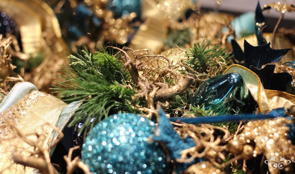 Hues of blue with opulent gold ribbon and gold dipped Bonsai roots create an organic opulent look