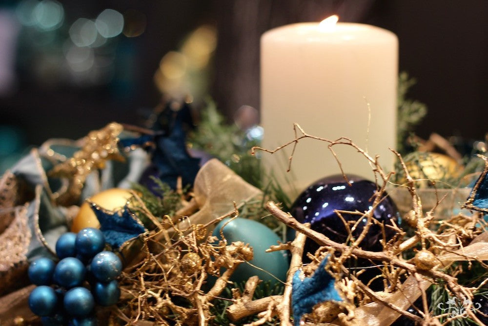 Contemporary design in turquoise,navy blue and gold; baubles, ribbon and gold dipped Bonsai roots.