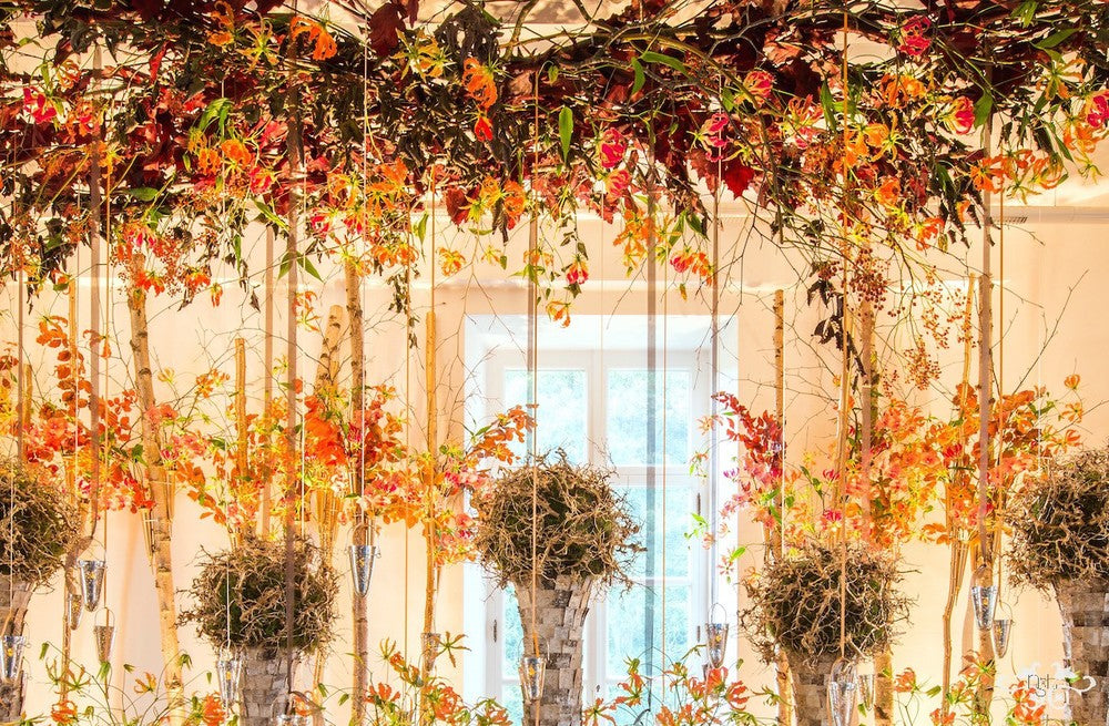 The inspiration for Neill's design came from the autumnal scenery of the gardens at Alden Biesen, seen through this window.