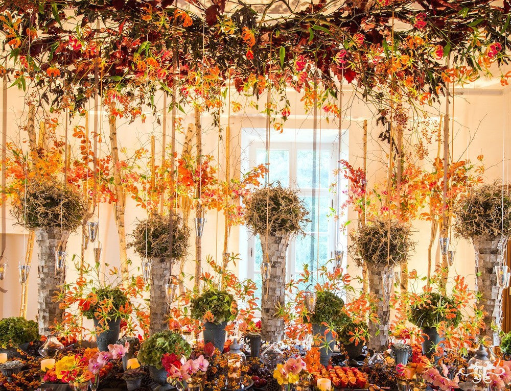 The Birch trunks filled with foliage and Gloriosa created a forest feel to the room.