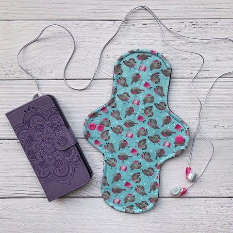 reusable pad beside a phone with earbuds