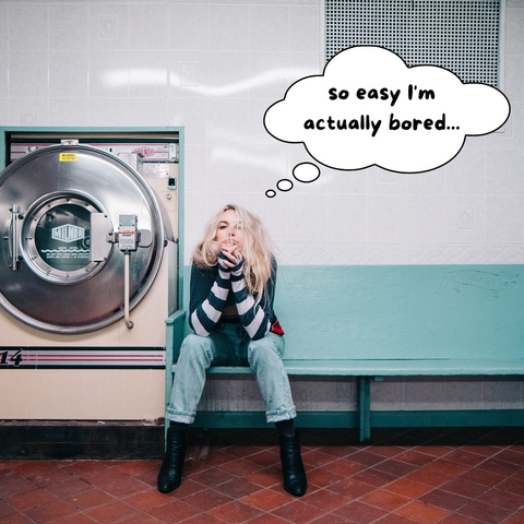 woman looking bored by a washing machine with text so easy I'm actually bored