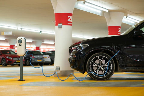 black-electric-car-charging-in-parking-lot