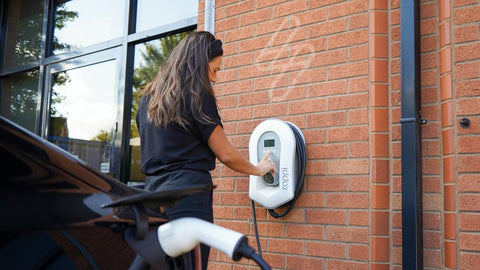 woman using ev charger