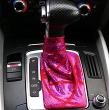 Load image into Gallery viewer, Love to Shift holographic hot pink custom shift boot cover for an automatic car shown in an Audi Q5 from a frontal view.