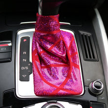 Load image into Gallery viewer, Love to Shift holographic hot pink custom shift boot cover for an automatic car shown in an Audi Q5 from a closeup frontal view.