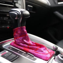 Load image into Gallery viewer, Love to Shift holographic hot pink custom shift boot cover for an automatic car shown in an Audi Q5 from a side angle view.