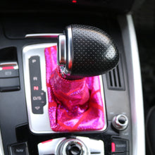 Load image into Gallery viewer, Love to Shift holographic hot pink custom shift boot cover for an automatic car shown in an Audi Q5 from a bird's eye view.