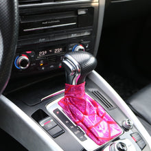 Load image into Gallery viewer, Love to Shift holographic hot pink custom shift boot cover for an automatic car shown in an Audi Q5 from a side angle view above from afar.