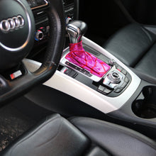 Load image into Gallery viewer, Love to Shift holographic hot pink custom shift boot cover for an automatic car shown in an Audi Q5 from a side angle view from above.