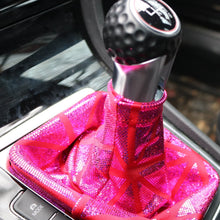 Load image into Gallery viewer, Love to Shift holographic hot pink custom shift boot cover for a manual car shown in a VW GTI from a side angle view.