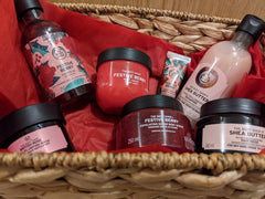 Festive hamper product image, showing a range of pampering products (hand cream, shower gel etc)