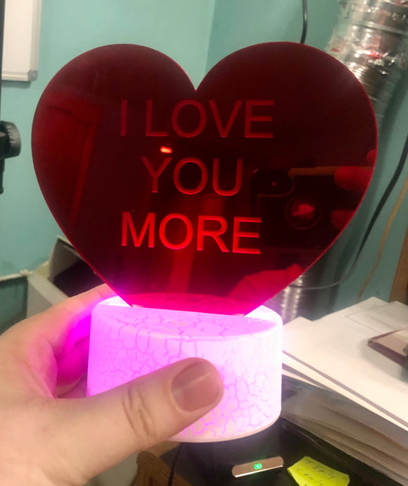 Acrylic mirror heart with LED base.
