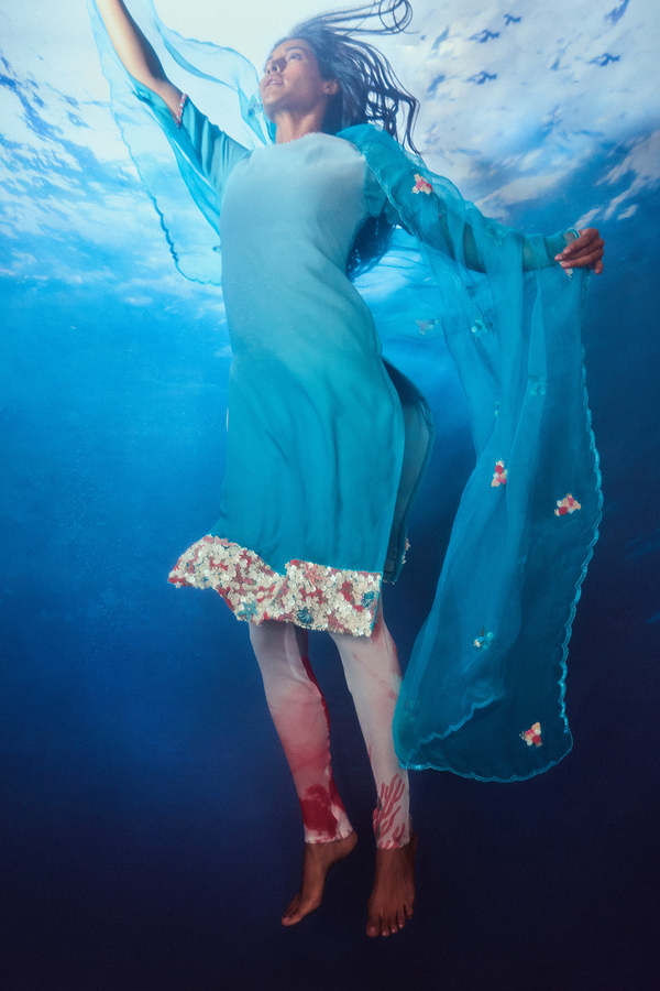 Arctic and Cerulean Blue Ombred Straight Kurti with Coral-printed Long Tight-fitting Trousers and Net Dupatta