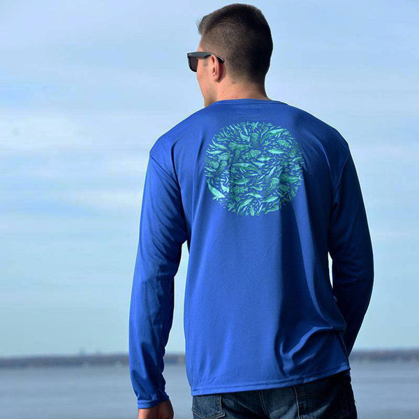 young man in royal blue performance fishing shirt by Hook Life on the water