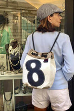 Bucket bag, shoulder bag, backpack handmade from repurposed sailcloth and nautical canvas by jm sails and bags in Italy presented by model