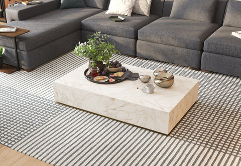 DE.CI Furniture Cozy Living Room with CU.BE Coffee Table and Patterned Rug