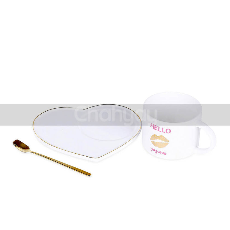 White Cup with Heart Shaped Saucer and Golden Spoon