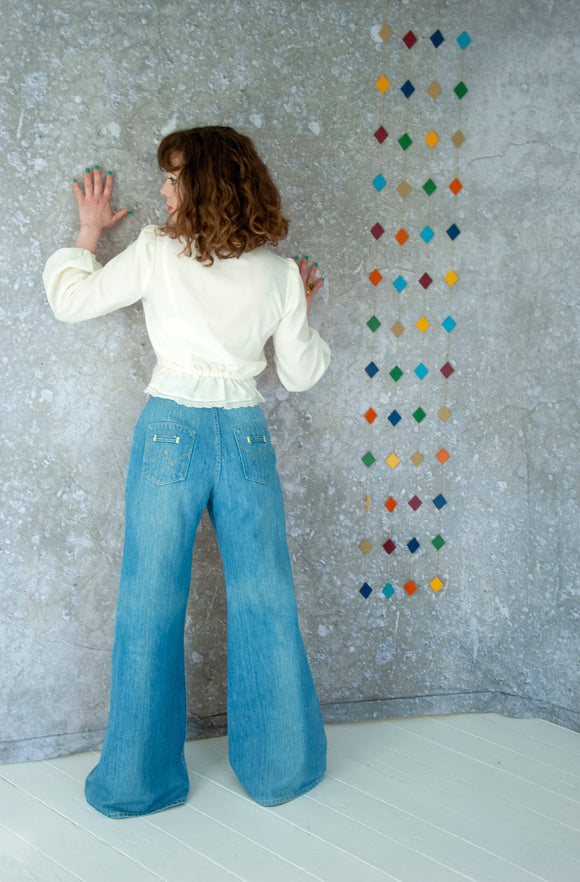 Vintage bell bottom jeans, faded light blue denim jeans pants high waist cotton bellbottoms bell bottoms boho retro 1970s L Wrangler