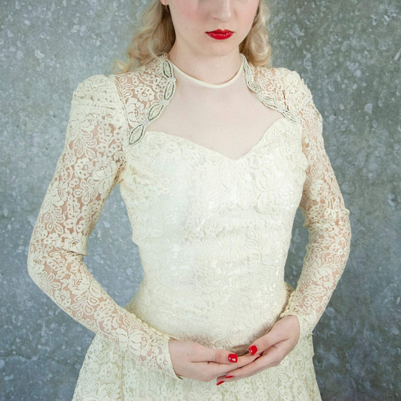 Vintage 1940s ivory lace wedding dress, off-white long sleeve Chantilly sweetheart illusion floral beaded gown, peplum netting train XS