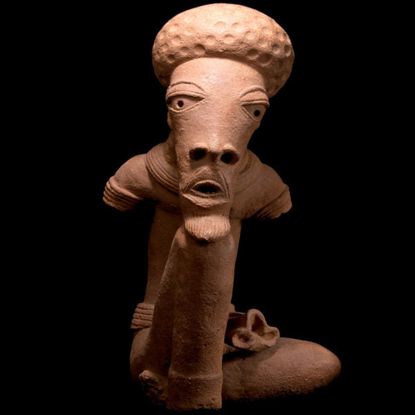 Beautiful and important Nok Terracotta Figure of Seated Man. TL Test. I-II Century AD.