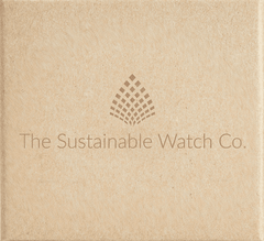 The Sustainable Watch Company's recyclable and sustainable packaging, made from brown cardboard with a faded dark brown logo in the centre.