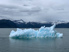 Melting Ice Berg in middle of vast lake shows the extent of climate change