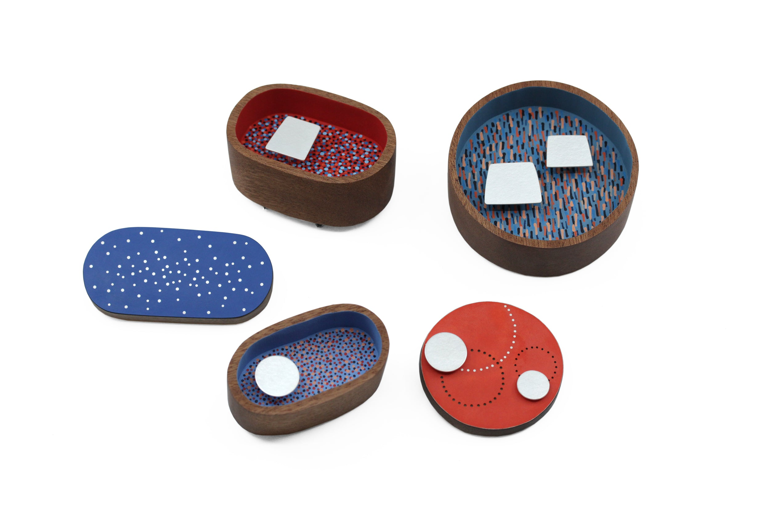 five brooches pictured together