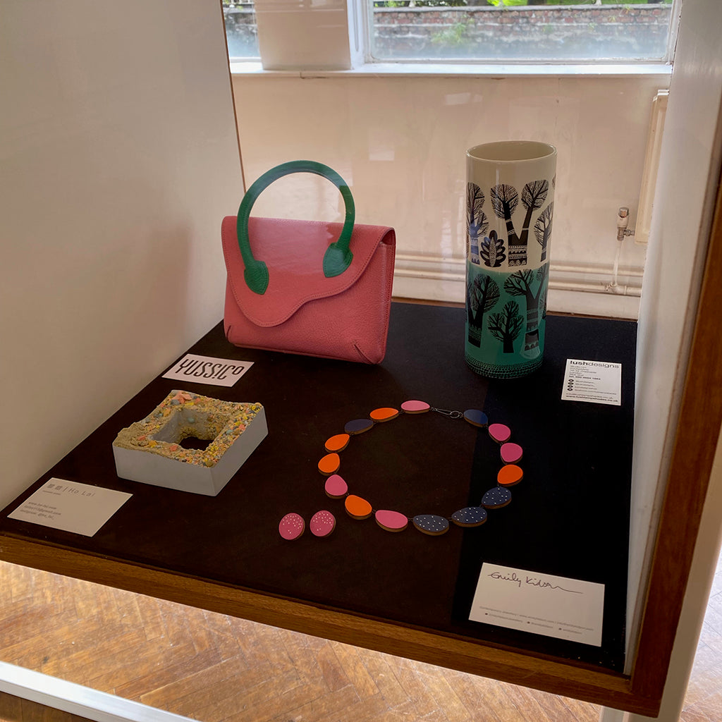 jewellery shown in display case alongside work by other Cockpit makers