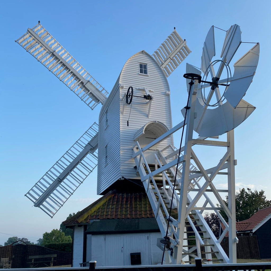 A windmill in Suffolk photographed against a blue sky
