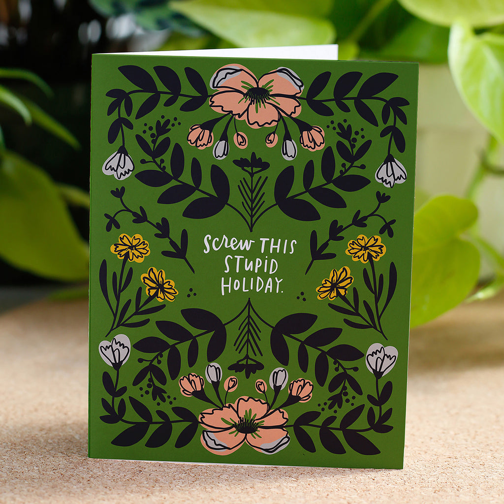Screw This Stupid Holiday card is green with floral illustrations.