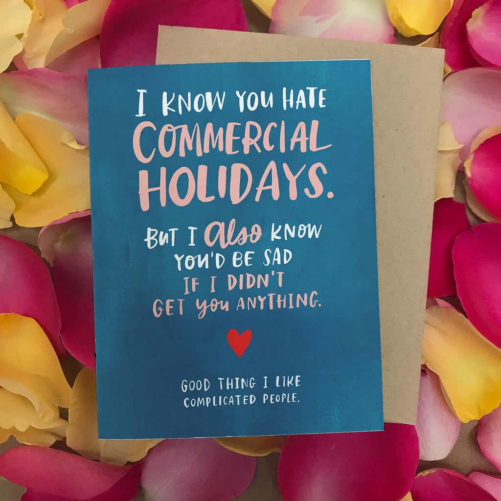 Blue Commercial Holidays card on top of floral arrangement