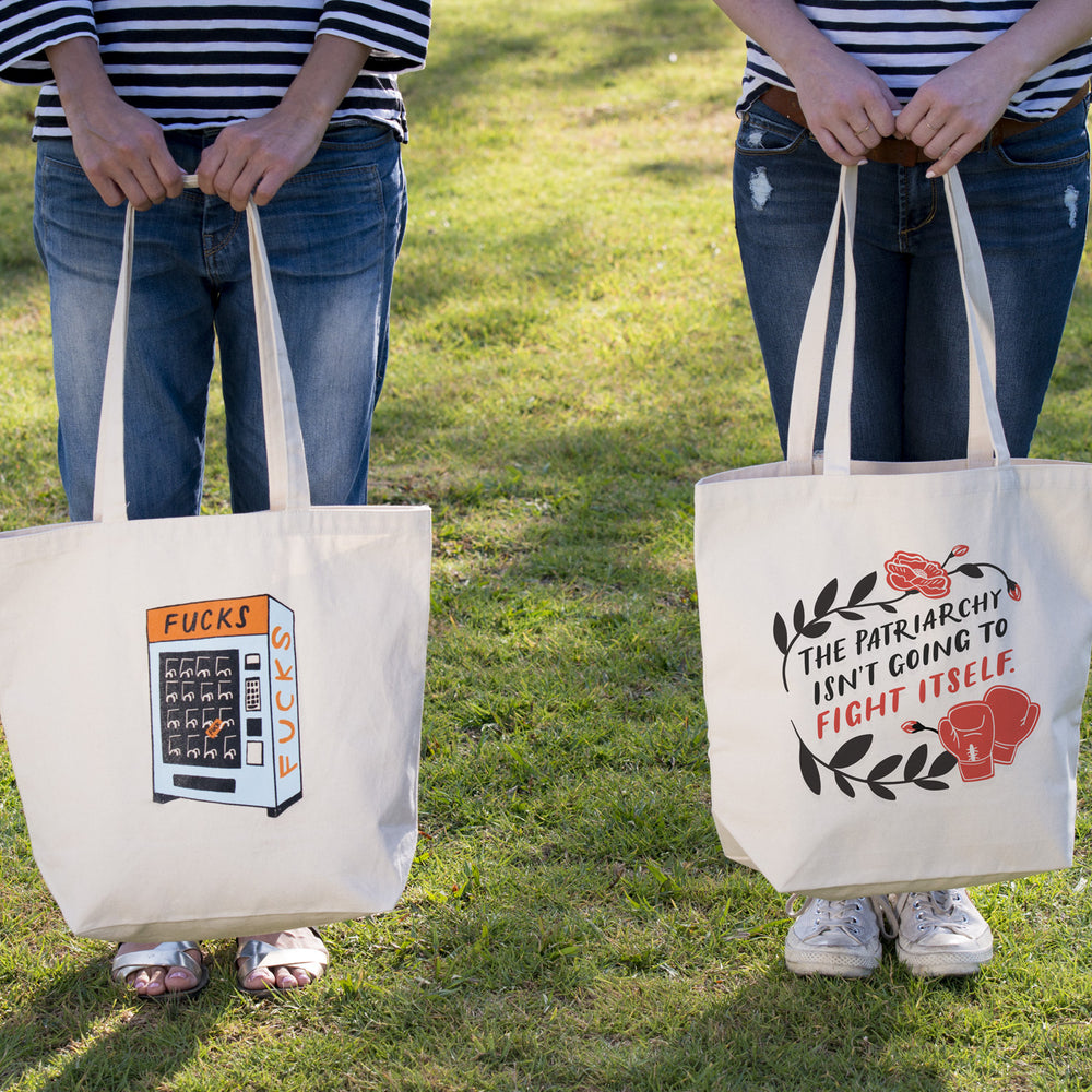 People holding Fucks Vending Machine Tote and Patriarchy Tote