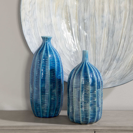 Earthenware vases finished in a cobalt blue glaze with carved textural detail. Sizes: S-6x13x6, L-7x15x7