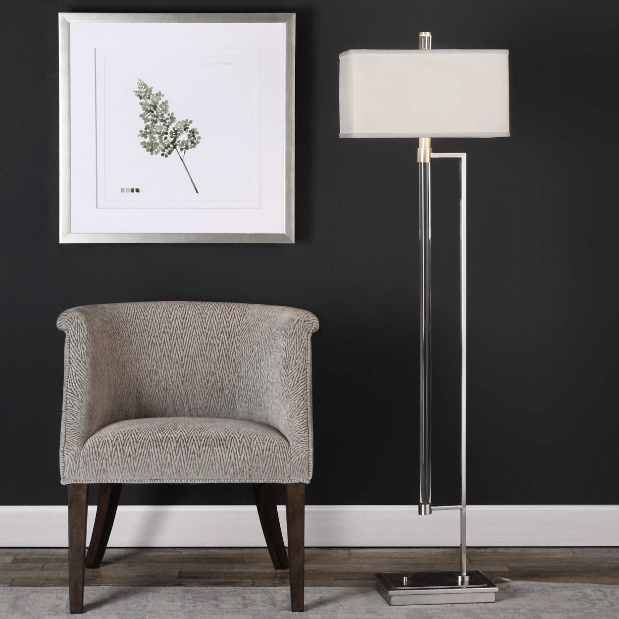 "Thick, clear acrylic rod supported by forged iron finished in plated polished nickel. The rectangle hardback shade is a white linen fabric with light slubbing. Shade is 10""H."