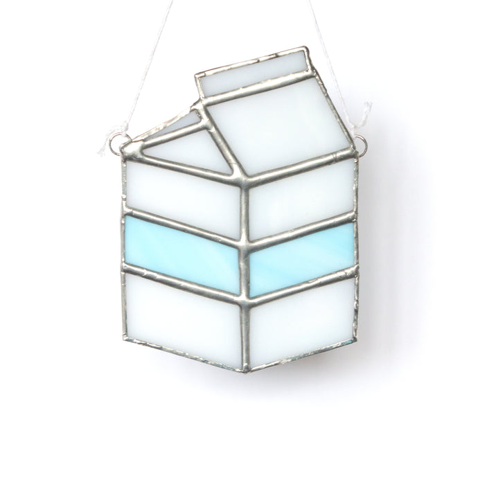 Super cute handcrafted milk carton miniature stained glass suncatcher in white and pastel blue with silver finish.