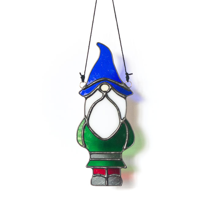 Handcrafted garden gnome stained glass suncatcher with cobalt blue hat, white beard, emerald green shirt, gray belt, ruby red pants and gray shoes.
