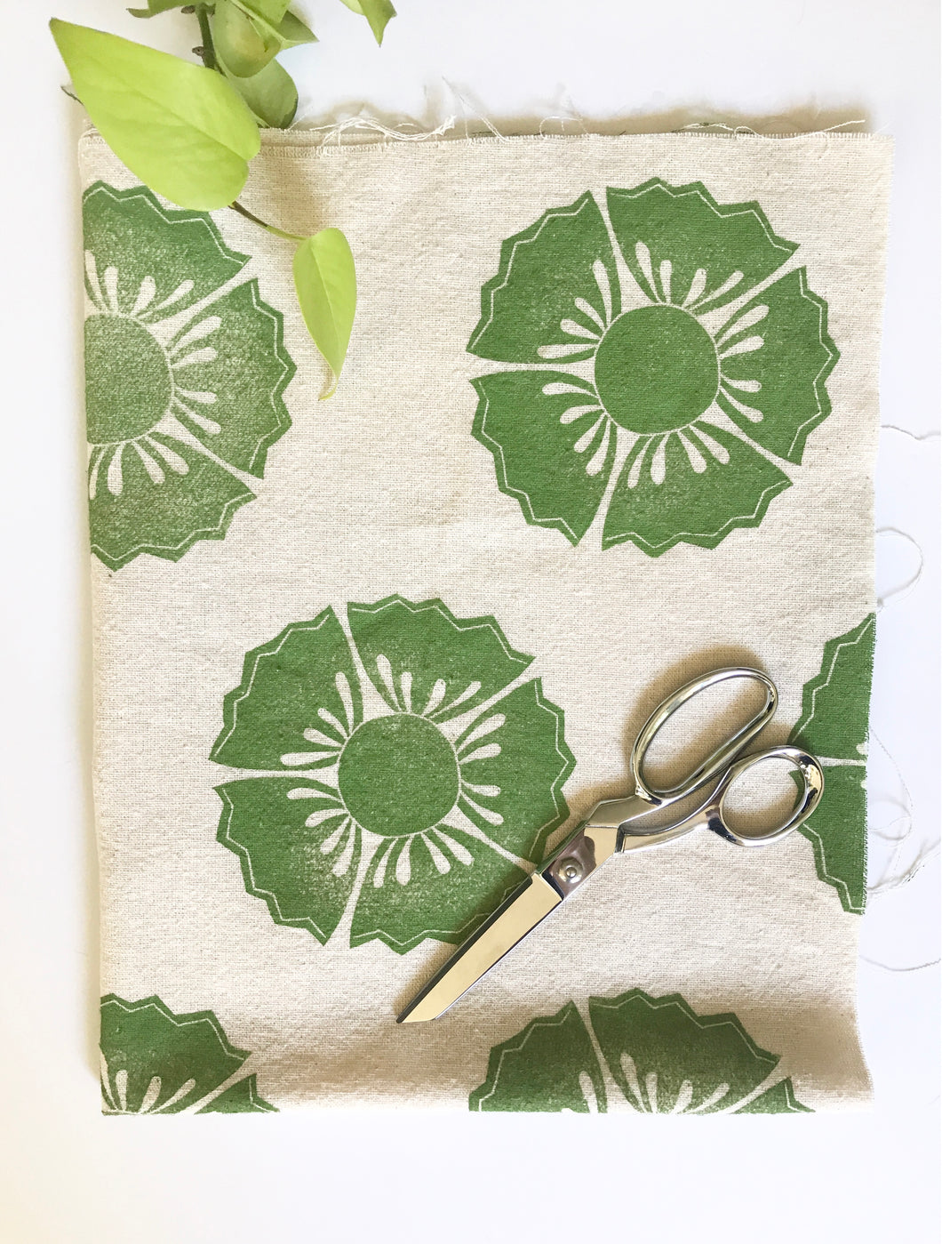Large floral print in green on 100% cotton fabric.