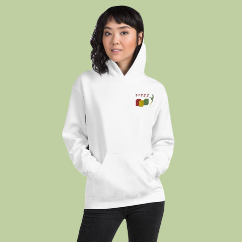 woman wearing Back a yard vibes white hoodie against green background