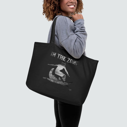 Woman with large black tote bag with writing and image