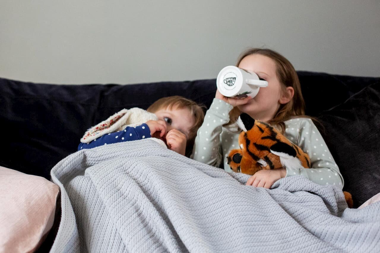 young kids drinking herbal tea before bed