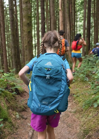 girl on walk with backpack
