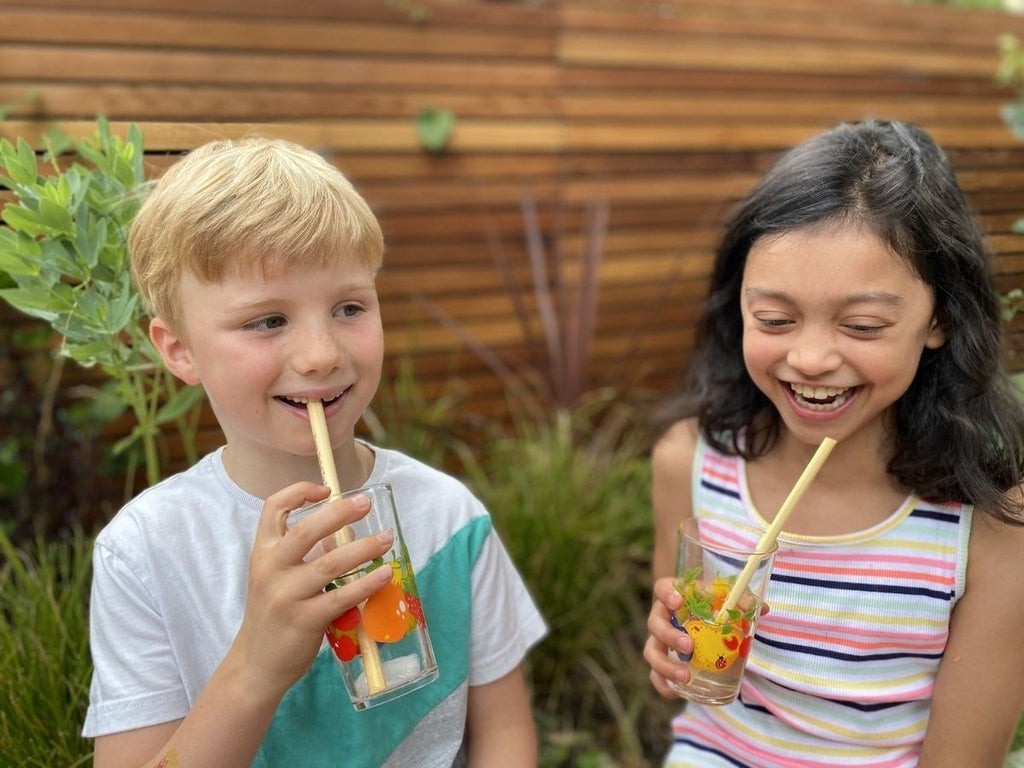 boy and girl drinking iced tea outside