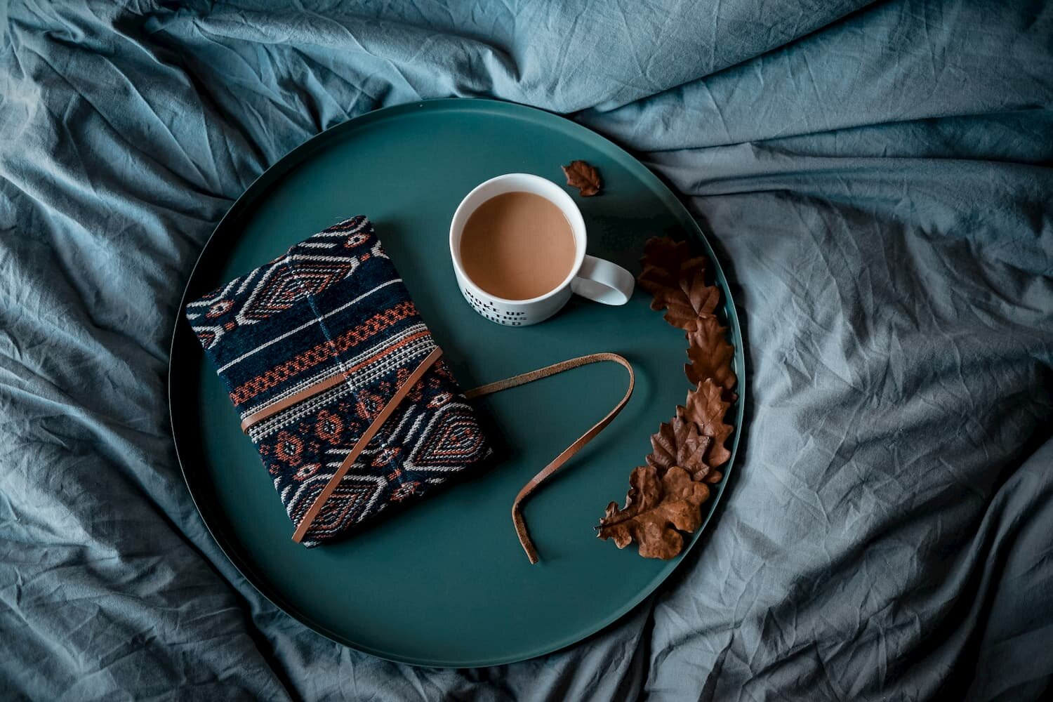 tray with tea and journal on bed credit unsplash