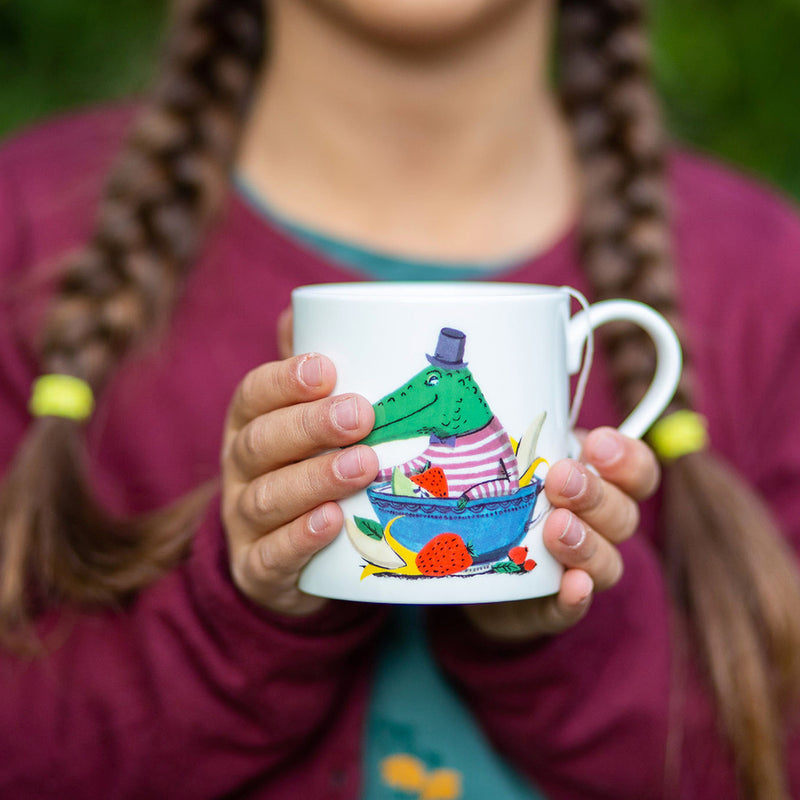 Girl holding mug of Jolly Croc fruit tea