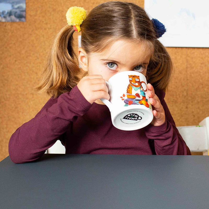 Girl drinking from Merry Tiger mug