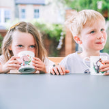 Kids drinking tea from Happy Toucan and Snoozy Fox kids mugs
