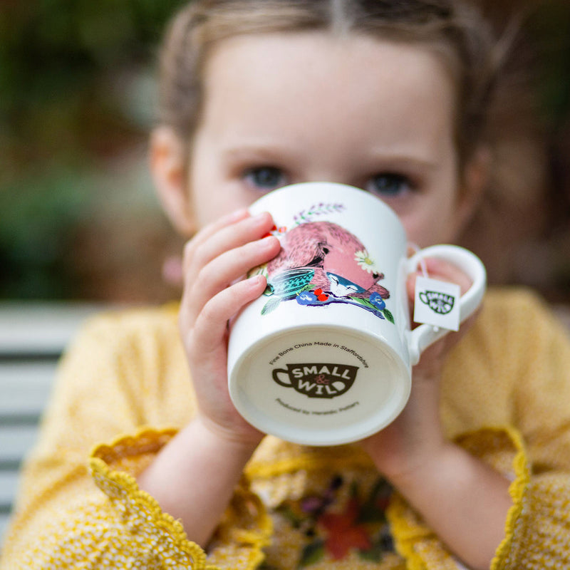 Child drinking herbal tea from Snoozy Fox mug and tea bundle