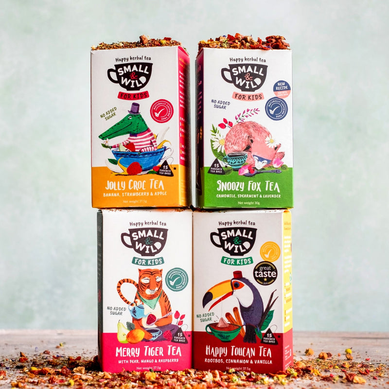 4 boxes of kids herbal & fruit teas stacked with loose blends