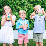 Children holding up packs of Small & Wild herbal and fruit teas for kids
